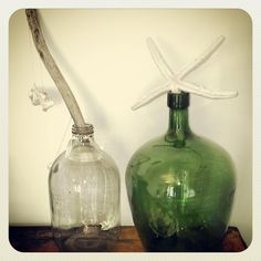 Driftwood collected off beach in NSW by friend. Vintage bottles. Demijohn for wine & cordial bottle. Love!