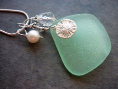Sea Foam Sea Glass Necklace Sand Dollar Beach Glass Sterling Jewelry Pendant  This gorgeous sea glass necklace is just stunning in its thick shape and heavy frosting! Sea glass piece is perfectly frosted to total perfection ! No sharp edges.  Beautiful GENUINE sea glass in a deep sea foam green really shows all the detail in the sterling silver Sand Dollar charm. The sea glass is wire wrapped in solid sterling silver wire with swarovski bead and sterling spacer beads. Clear crystal teardrop…