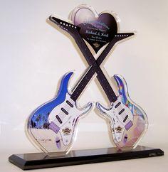 "36"" acrylic guitar sculpture.  Cut from .75"" clear cast acrylic & uv printed subsurface.  http://www.edco.com/cat/custom-awards"