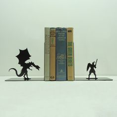 Dragon & Knight Bookends - Free USA Shipping. $44.99, via Etsy.    LOVE THIS