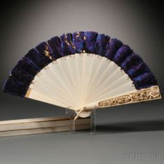 Monogrammed Ivory Brise Fan, China, 19th century, tips of the sticks decorated with iridescent purple feathers, one guardstick carved with floral decoration