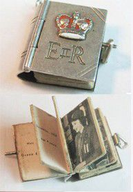 Vintage Queen Elizabeth II silver photo album charm...There has got to be a way to incorporate this into a wedding or special event