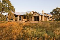 Texas limestone ranch house with recycled barn wood