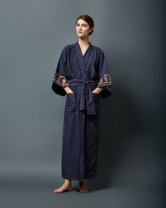 Long kimono gown in fine, lustrous, khari printed cotton/silk. Traditional square-cut sleeves. Two patch pockets. Wide, wrappy tie.