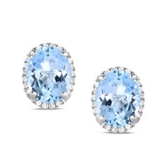 For the March birthday girl, these refined gemstone and diamond earrings create a sensation. Crafted in cool 14K white gold, each dramatic design features a 9.0 x 7.0mm oval-shaped icy-blue aquamarine wrapped in a frame of shimmering diamonds. Radiant with 1/6 ct. t.w. of diamonds and a bright polished shine, these chic earrings secure comfortably with friction backs.