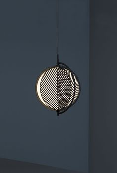 antonio facco created the 'mondo' — a lamp which reminds of a globe. it consists of movable metal shades allowing the beholder to interact with the lamp. Lamp Design, Lighting Design, Ceiling Lamp, Ceiling Lights, Journal Du Design, Ceramic Light, Light Fittings, Lamp Light, Floor Lamp