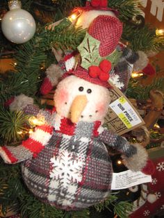 Snowman ornament From the Chalet Chic Theme at Your Christmas Shop at Stauffers of Kissel Hill Garden Centers. (http://www.skh.com/home-garden/departments-2/the-christmas-shop/)