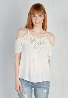 Maybe it's the way you move that makes you so alluring, or maybe it's this white top! Spaghetti straps and short sleeves frame the exposed shoulders of this flowy garment, and detailed with a crocheted neckline motif, this piece is instrumental to your 'je ne sais quoi'!