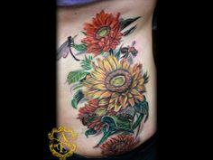Sunflower with Bees Rib Tattoo done by Sean Ambrose at Arrows and Embers Custom Tattooing