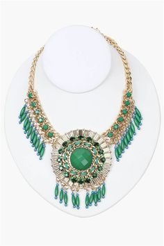 Bead Statement Necklace in Gold/Green A great statement necklace that has cool bead detailing throughout. This necklace has a great emerald color throughout with gold chain detailing. Has multiple holes for length adjustment and comes with matching earrings.