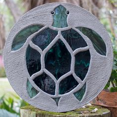 This pretty sea turtles shell is made with hunter green wispy stained  glass. The flippers e44fa8ca5c