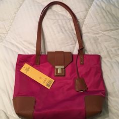 Tory Burch Penn Mini Tote Super cute hot pink Penn mini tote. Only used for like an hour and realized I needed a bigger purse. Still has the tag and inside plastic over the Tory symbol. No marks at all! Tory Burch Bags