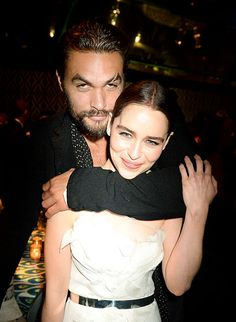 Drogo and Khaleesi reunited! Jason Momoa wrapped his arms around Game of Thrones costar Emilia Clarke to pose for a photo together at HBO's after party.
