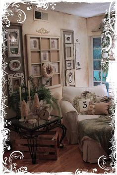 Great idea!  Long rectangle frames with beige backing and smaller white frame hung in it.  Love this entire wall with the old window in the center!!
