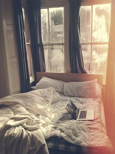 lazy summer mornings - love the bed up against large windows