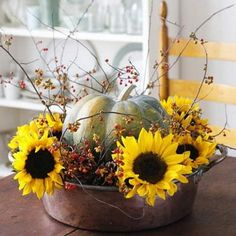 Creative floral designs with sunflowers are awesome table decorations and centerpieces