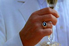 Agent 007 A multipurposed ring that records live, projects visual contexts, and virtual tools for real time function and purpose. 14. Ring Camera, <em>A View to A Kill</em> (1985)