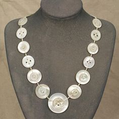 Ivory tapered vintage pearl button necklace  by unexpectedboutique...$94.CAD...The buttons are woven in place using a strong creamy coloured cotton cord, and the necklace is finished with sterling silver findings. The necklace measures 45cm including the clasp, with a sterling silver extension chain adding an extra 7cm of length. The largest button is 32mm across and the smallest is 11mm.