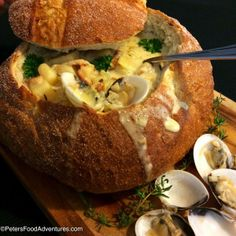 Authentic New England Clam Chowder made with real clams - served in a sourdough bread bowl.