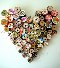Never knew what to do w/ all my cool old wood bobbins!