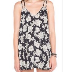 B&W flower dress Hardly ever worn & super comfy Brandy Melville dress. It says OS, but I think it is mor on the medium side honestly! Super cute as a beach cover up or with a bandeau underneath. ✨✨✨✨✨✨✨✨✨✨✨✨✨ Brandy Melville Dresses Midi