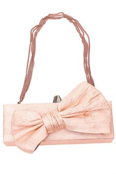 Pale pink bow clutch by Maria Lucia Hohan.
