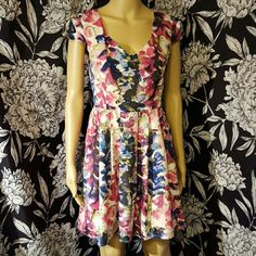 Watercolor floral dress So beautiful & unique! Polyester multi color dress with floral pattern that looks like it was painted. Perfect for spring! Features exposed zipper in back & cut out detail on sleeves. Stunning! Mimi Chica Dresses Mini