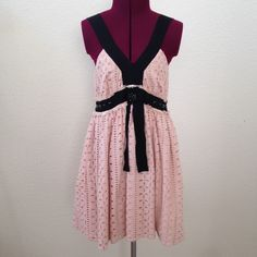 """FOREVER 21 Girly dress Very cute dress. Peach and black colors combo. Low V-neck neck line.1.5 inches should strap. Empire waist (under breast section 30inches"""") with black crystal, ruffle lace details. Eyelet design. Dress length is 32 inches ( tip of the should strap to skirt bottom). Forever 21 Dresses"""