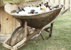 Serving drinks in a old wheelbarrow. Rustic - Vintage - Wedding -Engagement  Party - Country - couple's shower - Summer party - crawfish - seafood boil