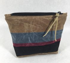 Waxed Canvas Zippered Pouch   Looking for a DIY gift idea? Then this simple make up bag is just what you're looking for!