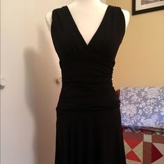 Little black dress Little black dress with low v cut neckline and flattering rouching detail around midriff. Still hits my knees (I'm 5'6) so not too daring. Great party dress!! Velvet Torch Dresses