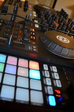 Native Instruments Traktor setup. This is, in my opinion, the best setup for Traktor, a Traktor Kontrol S4 (the mark II would be better) and a F1 (possibly 2 on each side of the S4)