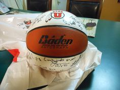 Signed by the 2012/2013 Women's basketball team and three coaches for a silent action at Relay for Life in Magna August 9, 2013