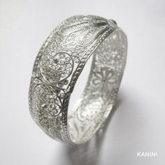 Traditional-style handmade filigree bangle made from silver by skilled artisans. Feel free to email us with any requests at kanini.jewelry@gmail.com.  We look forward to hearing from you!