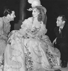 Robert Young and Franchot Tone visiting Norma Shearer on the set of Marie Antoinette, 1938.
