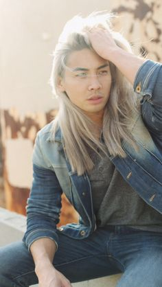 Asian man with long white hair