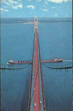 Old postcard, freighter going under the Mackinac Bridge.