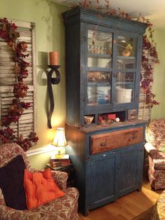 Awesome chippy hutch from Restoration Emporium #falldecor #homedecor #livingroom
