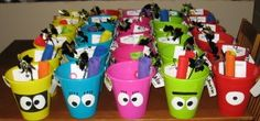 Favor Buckets! This blog has a whole yo gaba gaba theme party. Matthew really wants the cake I posted earlier but not sure I am that talented!