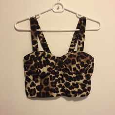 Leopard Bustier Crop Top Wet Seal leopard print bustier crop top with built in padded cups. Stretchy back and straps to fit comfortably. Worn only twice, great condition! Willing to accept offers! Wet Seal Tops Crop Tops