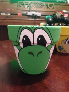 """Yoshi painted flower pot to hold """"yoshi eggs candy"""""""