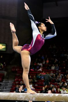 University of Denver gymnast Nina McGee holds a pose on beam. Photo taken on March 7, 2015, in Magness Arena at DU.