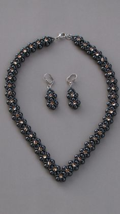 RAW V shape necklace with pearls, seed beads and swarovski bycons.