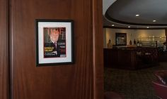 FAKE Framed portrait of President Donald Trump on the cover of a Time Magazine hanging from a column in the Champions Sports Bar & Grill at the Trump National Doral Miami.