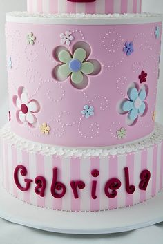 Pink Fondant Cake With Daisy Cut-Outs and Stripes. Baby Cakes, Girly Cakes, Sweet Cakes, Gorgeous Cakes, Pretty Cakes, Cute Cakes, Amazing Cakes, Fondant Cakes, Cupcake Cakes