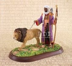 Ebony Visions The African Kings #EbonyVisions #Art. Created as a companion piece to The African Queen, the kings complete the royal set. Retired June 2007. Once the Heirs, the two African Kings walk in unison across the great Savannah surveying their domain. With staff firmly in hand and dressed in a gilded violet robe, the King shows stately presence as the leader of his Kingdom. With strong hands he grips the leather leash connecting him to the King of beasts.