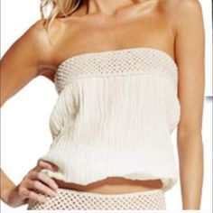 Crochet and cotton gauze halter top.  So cute! ☀️ So unique!  The crochet band can be worn on top or bottom depending what look you are going for.  Cream colored cotton gauze with thin band of elastic on the other end. ELAN Tops