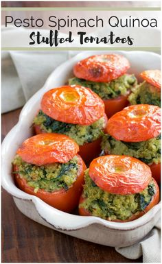 These roasted stuffed tomatoes are filled to the brim with a flavorful mixture of pesto quinoa and fresh spinach. Your whole family will love this simple vegan recipe! Vegan, dairy-free, and gluten-free.
