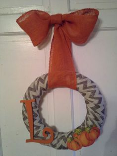 Burlap fall wreath. Do yellow with purple letter and bow.