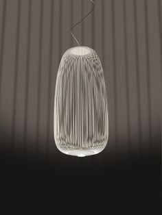 Shop SUITE NY for the Spokes suspension light designed by Garcia Cumini for Foscarini and more modern Italian lighting and design. Italian Lighting, Modern Lighting, Lighting Design, Chandelier Pendant Lights, Pendant Lamp, Chandeliers, Lampe Led, Led Lamp, Suspension Cable
